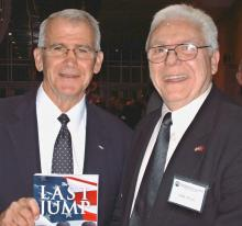 John E. Nevola with Col. Ollie North